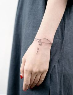 Wrist ribbon tattoo
