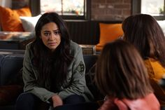 Pin for Later: While You Were Distracted by the Drama on Pretty Little Liars, We Were Looking at the Outfits  Emily's army-inspired layer is versatile enough to throw on year-round.