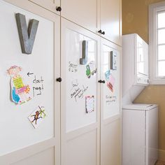 Add a dry-erase message board to a laundry room, kitchen, or kids' play area—just by painting a wall or other surface, such as the recessed panels in cabinet doors (shown). IDEA white interior high-gloss dry-erase paint, $30 for 6 square feet of coverage; lowes.com -- Would be fun to add to boys' room between panels.