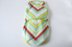 Baby swaddler, swaddle blanket/wrap, multicolor chevron--ready to ship. $40.00, via Etsy.