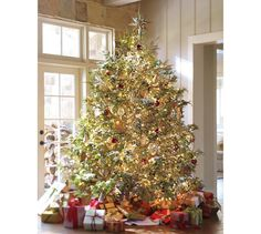 ..this looks ideal xo Mirrored Star Tree Topper | Pottery Barn