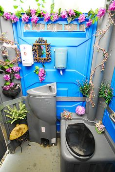 """Great idea for making a porta potty more """"usable""""/welcoming. decorated porta potty"""