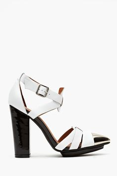 Don't Care Platform $148 - kind of dying for these white hot heels for LA summertime