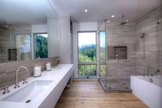 Contemporary Master Bathroom with Drop-In Bathtub, Double sink, Inset cabinets, Flat panel cabinets, Corian counters
