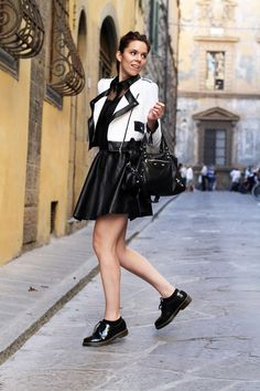 dr martens shoes, leather black skirt and a white and black jacket with balenciaga bag. Here my outfit of the day :))