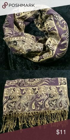 Gold Purple and Black Paisley Print Scarf Super gorgeous and versatile paisley print scarf.  Measures approximately 27 inches wide by and approximately 6 foot long.  This scarf can be styled so many different ways - dressed up with a blouse and skirt or casual with jeans and a t-shirt.  Gently used - no flaws found upon inspection - see photos.  Smoke free, pet friendly  Thank you for looking! Accessories Scarves & Wraps