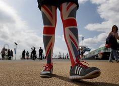 London 2012 Emotional Moments - Slideshows | Sophie Mase walks through the Olympic Park.  (Photo: Jae C. Hong / AP) #NBCOlympics