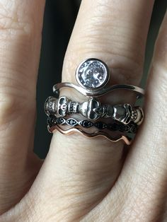 From one of the cities in Essos, Tyria has it's rich and edgy histories in the world. The Tyria stacking set designed with a bezel set lab diamond, a platinum skull eternity ring and a black diamond patinum band with a rose gold band. Gems Jewelry, Hair Jewelry, Jewelry Gifts, Jewelry Box, Silver Jewelry, Alternative Engagement Rings, Lab Diamonds, Eternity Ring, Gold Bands