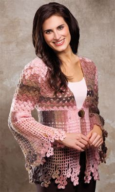Lovely cardigan, but in a different color, though... Pattern available (new issue crochet magazine)  -I agree!  Much better in a solid color.