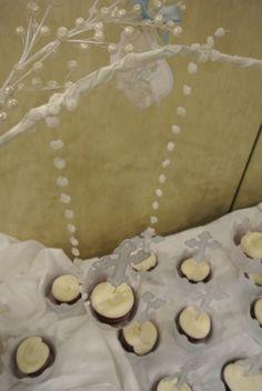 Downward view of baptism cupcake hanging in tree