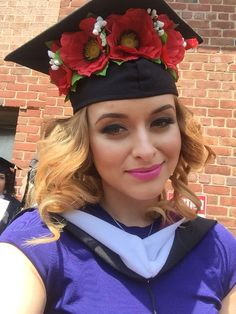I graduated with my Masters in Mental Health Counseling. Love my cap decorated with poppy flowers