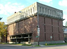 Frank Lloyd Wright, Albert D. German Warehouse. Constructed in 1915 in Richland Center, WI. An imposing cube of brick and cast-in-place concrete, the design is evocative of ancient Mexican architecture.