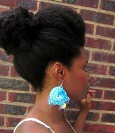 Natural Afro:Textured bun with a pompadour