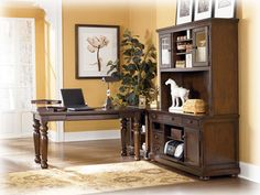 The Porter home office furniture set comes with a large desk, corner table, credenza, and a large hutch.
