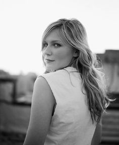 Kirsten Dunst.    ~your smile always seems to find its way through beneath your quiet eyes.