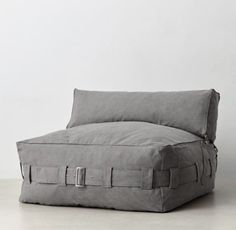 RH TEEN's Cargo Lounge Armless Chair:Inspired by fashion's casual silhouette, our lounger offers the slouchy comfort of a bean bag. A strappy belt allows you to adjust for fullness, while side pockets keep remotes, game controls and other necessities at hand.