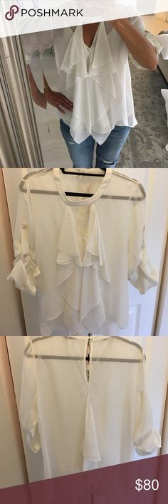 BCBG ivory sheer ruffle blouse Excellent condition. Silk, sheer, all tags removed because of the sheerness. Sleeves have roll tab. BCBG Tops Blouses