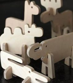 Plywood animals with interchangeable bodies: llama, deer, crocodile, camel, elephant, moose.