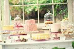 Love the different cake stands in varying heights and sizes