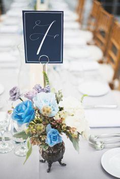 calligraphy table numbers and shades of blue centerpieces Photography by Rebecca Hansen Weddings / rebeccahansenweddings.com, Event Planning by The Boutique Group / theboutiquegroup.com/, Floral Design by The Designers Co-op / thedesignersco-op.com/