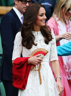 Kate Middleton at Wimbledon in a white dress and Anya Hindmarch clutch bag. www.handbag.com