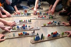 ateliers-enfants-0729.jpg awesome idea- kids can do their street, fantasy, historic/landmarks, etc. or squares with different biomes.