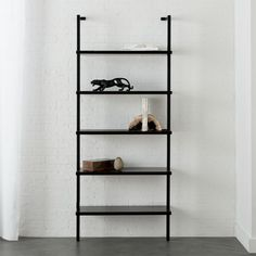 Minimalism scales for small spaces in clean, pristine white. A shorter version of our tall stairway white bookcase, five shelves ladder up in engineered wood with glossy lacquer. Black Bookshelf, Wall Mounted Bookshelves, Wide Bookcase, Modern Bookshelf, Bookcase Shelves, Wood Shelves, Glass Shelves, Bookcases, Walnut Bookcase