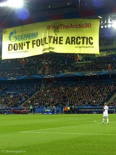 Greenpeace activists unfurl a 28m wide banner reading 'Gazprom Don't Foul The Arctic' at Basel's St. Jakob Park stadium, shortly after kick-off in the Champions League game between FC Basel and Gazprom sponsored, FC Schalke 04.