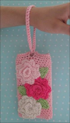 One more cell phone wristlet.  Case made with Tahki Cotton Classic, size G hook with a chain of 15.  Flowers crocheted from...