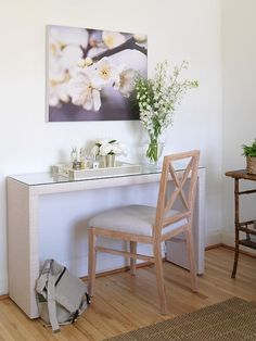Ikea Malm occasional table wrapped in Philip Jeffries raffia wallpaper with a glass slab top