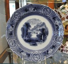 Antique Wedgwood flow blue Pearl Stone Ware California transferware plate dating to with an oriental gondola water scene.