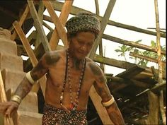 Mgngemah, Long House, Loincloth, Iban, Dayak, Tattoo, Decorated Body, Traditional Architecture, Malaysia, Native, Stairway, Wood (Material), Asian Ethnicity, Walking, 1 (Quantity), Man (Human), Adult, Stock Footage,