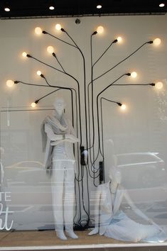 Simplistic outlines using electrical cables and lights at Macy's. Great idea to bring pattern and light to a scheme.