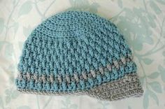 This is a modification of the pattern from The Laughing Willow.  For adult size, see her original post .   This size hat should fit th...