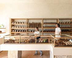 Los Angeles studio Commune has used plaster walls, wood built-ins and terracotta tile floors to create a rustic feel inside this bakery in Santa Monica. BreadBlok is a bakery founded by Chloé Charlie Plywood Furniture, Design Furniture, Plywood Floors, Kid Furniture, Modern Furniture, Bakery Interior, Interior Walls, Bakery Decor, Bakery Display