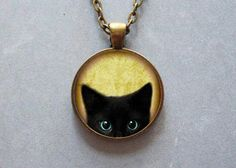 Black cat peeking face pendant wearable artwork by Iimagedeverre, $10.00