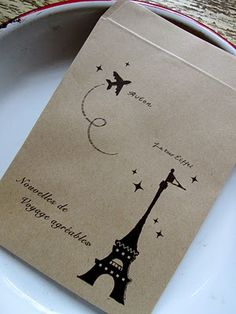 Gorgeous french party - Merci thank you cards in an envelope, made Paris snowglobes, natural perfume, thank you gift was travel kits, french guide luggage tag, journal etc.  Could do cafe setting