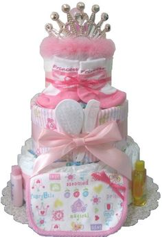 www.rubysdiapercakes.com http://www.rubysdiapercakes.com/item_66/3-Layer-Princess-Diaper-Cake.htm Here is a design fit for royalty! I didn't want to overpower this cake with dark pink so I used mainly pastel cotton-candy colored pinks and gave small accents of a more vivid pink to create this look. Princess Diaper Cake