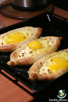 "Аджарские хачапури - (Russian) - Ingredients for ""Ajarian khachapuri"":      Adyghe cheese - 300 g     Flour - 300 g     Yeast (dry) - 5 g     Vegetable oil - 90 g     Egg - 4 pieces     Sugar (pinch)"