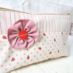 Making pouches is a fabulous way to use up all these pretty fabric scraps, buttons, trims and notions you've been keeping for ages!