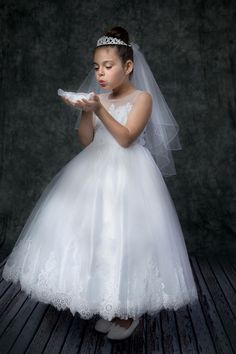 This First Communion Dress Features Sleeveless illusion bateau neckline, tulle and lace full length A-line First Communion Dress. This First Holy Communion Dress has a tulle skirt with scalloped lace hem. Buy Ivory First Communion Dresses Online White Communion Dress, Girls Communion Dresses, Confirmation Dresses, Baptism Dress, Girly Girl Outfits, Illusion, First Holy Communion, Holiday Dresses, Party Dresses