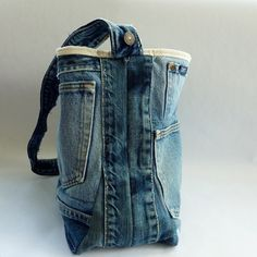 Upcycled Denim Tote Bag. Uses waist band and 2 flat pieces = depth.  If you used a really, really large pair of jeans, the waist could extend as the strap....  $42 on Etsy.