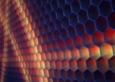 The SmartSlab has been described as the world's toughest digital video display for walls, floors, billboards and buildings. Each slab is designed in a honeycomb structure inspired by the optics of a fly's eye. Instead of using standard pixels it uses hexels (hexagonal pixels) that provide an 18% better resolution than just the standard pixel.