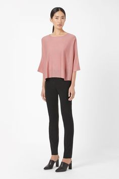 Made from finely knitted merino wool, this jumper has a contrast sheer panel along the back. Slightly cropped, it is a loose fit with a wide round neckline and relaxed kimono sleeves.