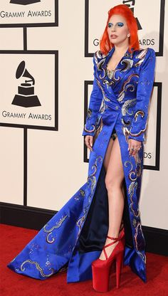 WHO: Lady Gaga  WHAT: Performer  WEAR: Marc Jacobs custom electric blue double-breasted satin coat dress embroidered with multi-colored sequins and decorative metallic elements by Maison Lesage with a high side slit and lacing up the back.