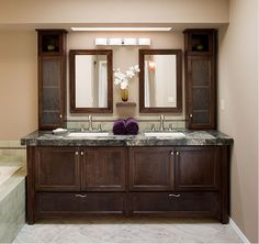 A large white vanity with double sinks provides plenty of space