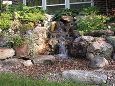 backyard and front yard landscaping with natural waterfall