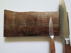 This is a 12 American walnut magnetic knife holder with beautiful crotch wood grain and a natural bark edge it has magnets spread to hold 6 large chef