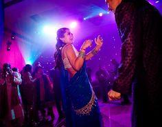 Bride dancing in Pink & Purple Lighting! Aline for Indian weddings