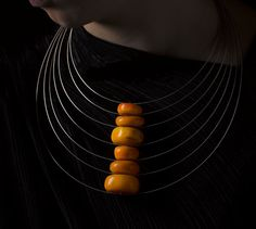 Linda van Niekerk  Neckpiece: Amber Traces 2011  Rare 'African Amber' and sterling silver  Image : Peter Whyte